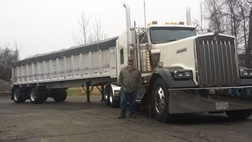 Owner, Clyde A. Hamilton posing with semi-truck